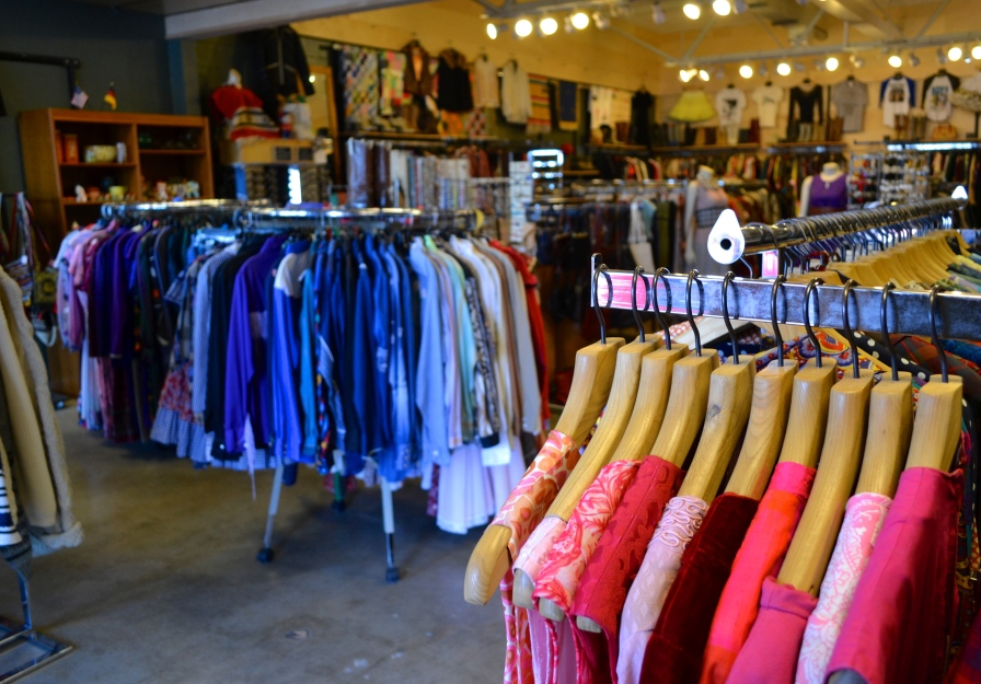 The store glows with color, selling everything from dresses from the 1920s to T-shirts from the 1970s.